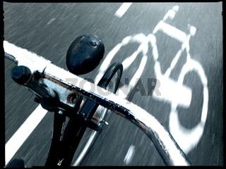 bicycle sign steer movement street dark rain amsterdam