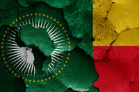 flags of African Union and Benin painted on cracked wall