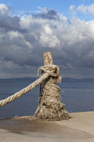 Rope on seafront, sea and beautiful cloudy sky in sunny summer day