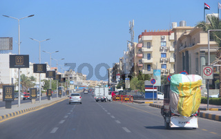 Transportation and traffic on highway in Hurghada city. City with street cars