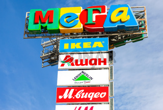 Logo of shopping center Mega against blue sky
