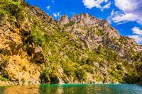 Verdon River flow between the sheer cliffs