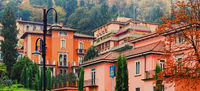 Residential buildings and gardens on the streets of Milan in Northern Italy, classic and historical European architecture in Lombardy region