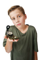 Boy with compass inquiring look on white