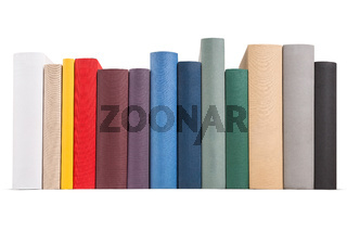 Row of different colored books.