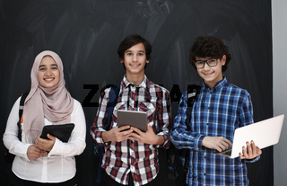 Arab teenagers group working on laptop and tablet computer