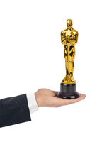 Hand with Award of Oscar ceremony