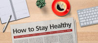 Newspaper on a desk -  How to stay healthy