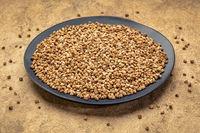 buckwheat kasha on a black plate