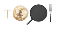Pancake, frying pan, spatula and wooden spreader