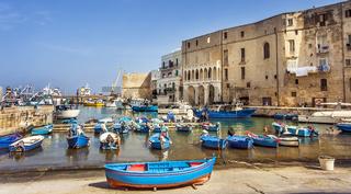 Fishing boats at the old port of Porto Vecchio in Monopoli Puglia Italy