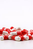 Various oval pills on white background