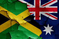 flags of Jamaica and Australia painted on cracked wall