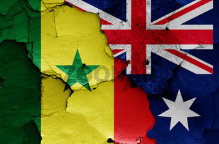 flags of Senegal and Australia painted on cracked wall