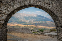 Stone Arch with a view of fortress ruins in Gjirokaster, Albania