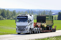 Volvo FH16 Semi Trailer Hauls Forage Wagon