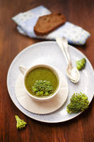 Delicious broccoli soup on table