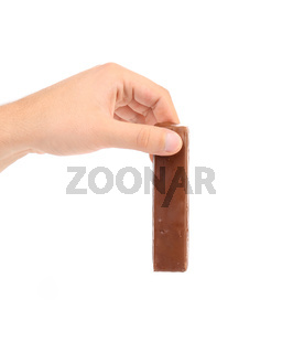 Hand hold chocolate bar.