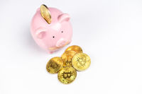 Pink Piggy bank with Bitcoin coin
