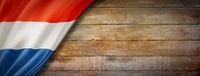 Netherlands flag on vintage wood wall banner