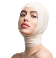 Girl her head and neck bandaged at plastic surgeon