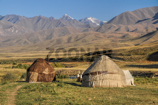 Nomadic settlements with yurts on green grasslands in Kyrgyzstan