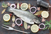 Rainbow trout and ingredients for cooking