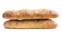 Two crispy fresh baguettes isolated on white background.