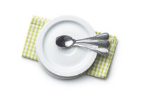 Dessert plates and spoons on checkered napkin