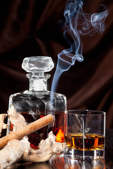 Smoking cigar and whiskey in glass