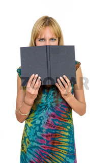 Portrait of beautiful blonde woman hiding behind book