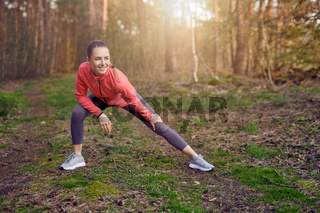 Fit young woman doing stretching exercises