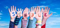 Children Hands Building Word Schule Means School, Blue Sky