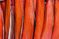 Close up view of lot fillet salted cold smoked red fish King Salmon. Prepared and ready-to-eat Pacific fish Chinook Salmon - Asian delicacy cuisine