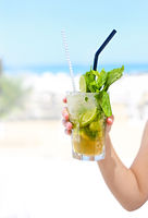 Little girl with mojito on beach