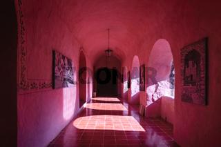 Corridor with arches of the former monestary Convent de San Bernardino de Siena in Valladolid, Yucatan, Mexico