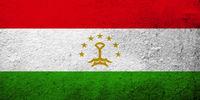 The Republic of Tajikistan National flag. Grunge background