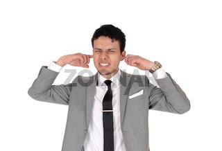 Young man holding his finger in the ear