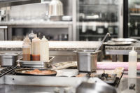 Food being cooked in commercial stainless steel kitchen in restaurant