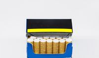 Group of cigarettes inside an open blue packet isolated on a white background.