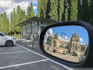 The cemetery of Bergamo reflected in the rearview mirror