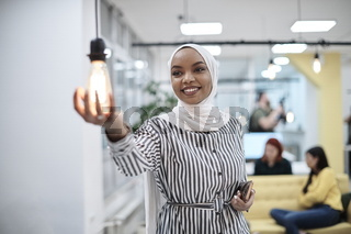 internet of things concept woman holding hands around bulb