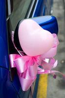 The close shot of wedding ballons and ribbon