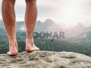 Man taking a break in nature and looking from summit down