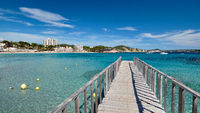 Empty wooden boardwalk leading to Mediterranean Sea clear green lagoon bay waters, freedom, vacation, free time, summer holidays concept, Palma de Majorca, Playa Peguera, Calvia Balearic Islands Spain