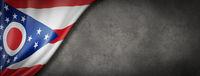 Ohio flag on concrete wall banner, USA