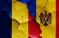 flags of Romania and Moldova painted on cracked wall