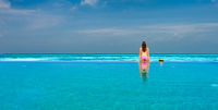 Woman in infinity swimming pool at Maldives