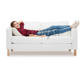 smiling teenage girl lying on sofa
