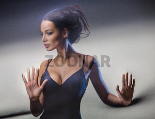 Graceful brunette stretches stretch mesh fabric in front of you